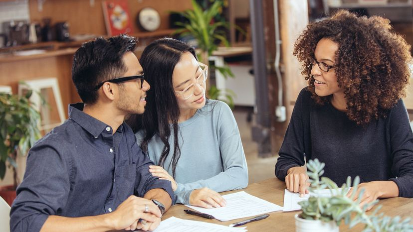 couple looking at loan with lender