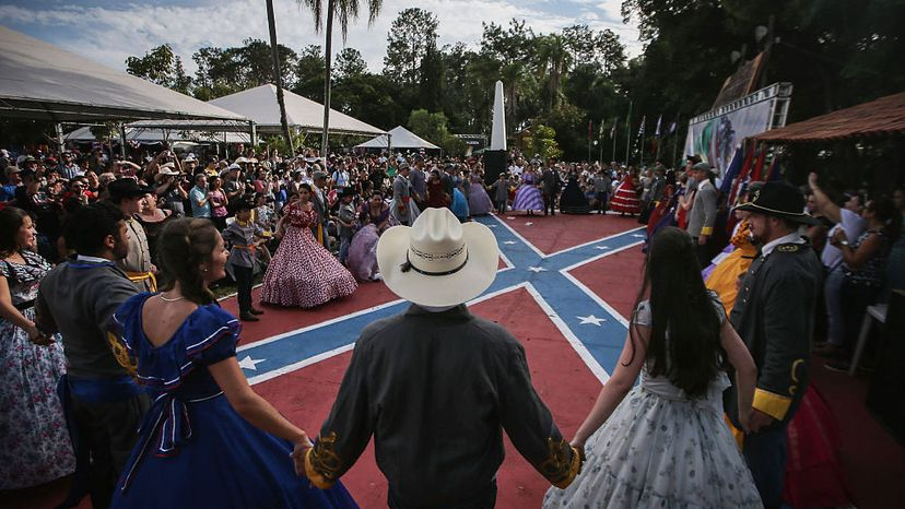 People in traditional outfits hold hands between dances at the annual Festa Confederada, or Confederate Party, on April 24, 2016, in Santa Barbara d'Oeste, Brazil. Mario Tama/Getty Images