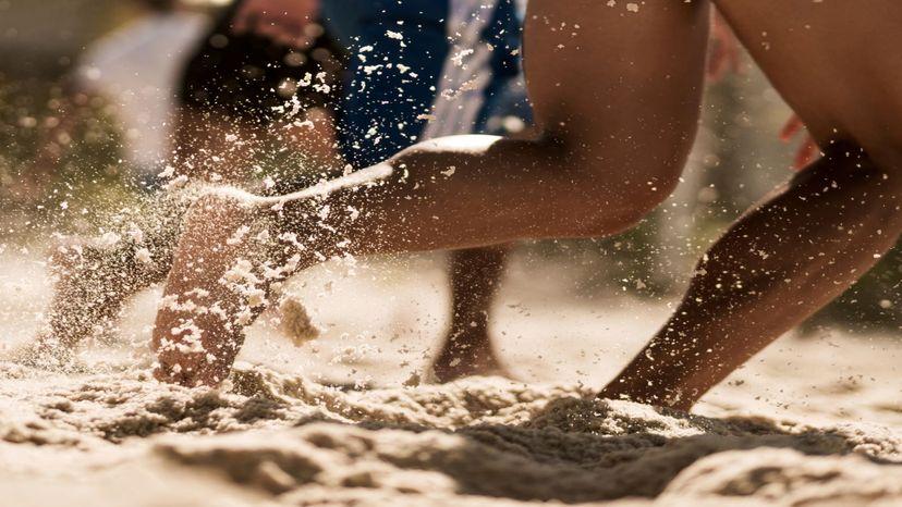 Bare feet running in sand