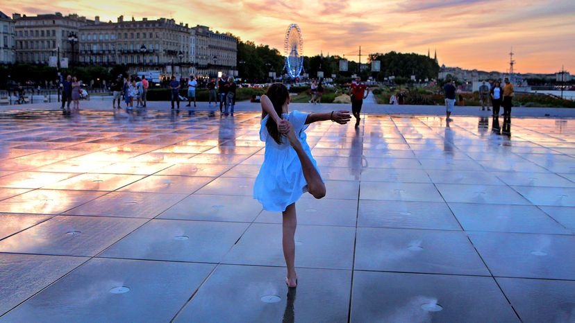 Young girl dances at Bordeaux's Water Mirror