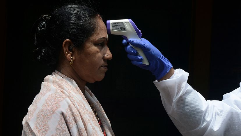 Woman having her temperature checked
