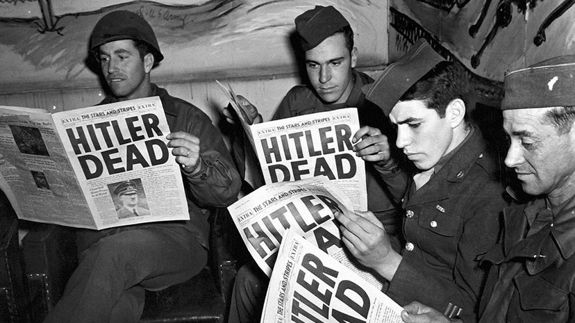 U.S. soldiers read about death of Hitler