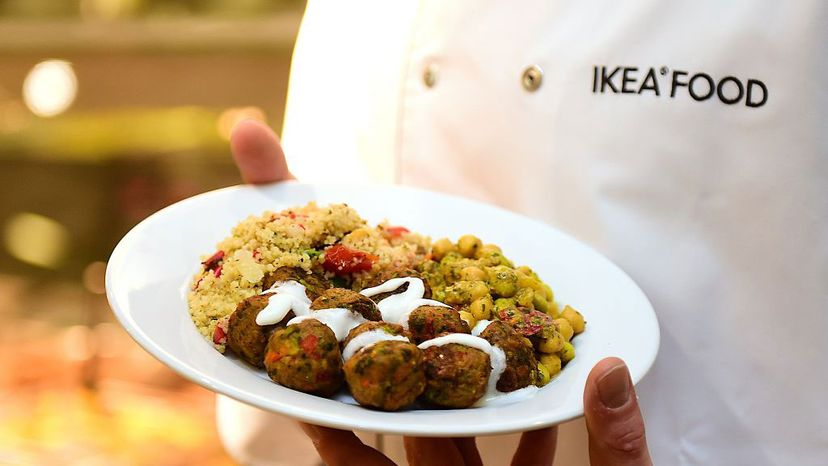 An Ikea employee displays the the company's vegetarian meatballs, during a worldwide launch at Ikea Anderlecht in Belgium, on April 8, 2015. EMMANUEL DUNAND/AFP/Getty Images