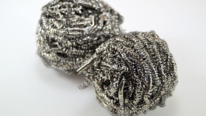 Metal scourer for clean on white background, close-up