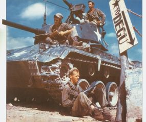 These American tankers and their M-24 Chaffee Light Tank guard a strong point near Degu in northwestern Italy.
