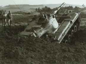 This M-47 Patton, which belonged to the 2nd Armored Division, clears a muddy obstacle somewhere in Korea in 1952.