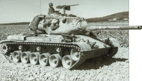 This M-47 Patton Medium Tank was nicknamed Chief Wahoo. It carried camouflage netting secured to the turret bustle.