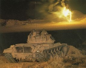 The M-48 Patton is shown here during a night firing demonstration.
