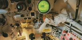 The control unit of the gunner is located to the far right. The green light indicates the system is functioning properly.