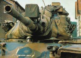 This M-60A3 carries the M68 105mm main gun. Note the shrouded infrared/white light searchlight above the gun.