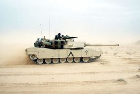 An M1A1 tank speeds across the Kuwaiti desert during Desert Storm. The M1's turbine engine gives the tank the power and agility necessary to maneuver in hostile environments.