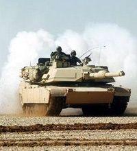 An M1A1 lays a smoke screen.