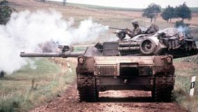 The M-1 tank has two main parts: a pivoting gun turret and a tracked hull.