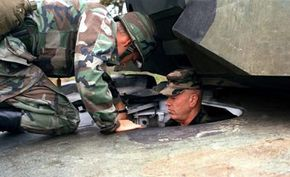 In the M1, the driver sits in the front of the tank hull.