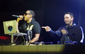 DJs have a choice of software programs to use when spining. Rapper Jay-Z, left, and DJ AM, right, spin together using music-mixing software.