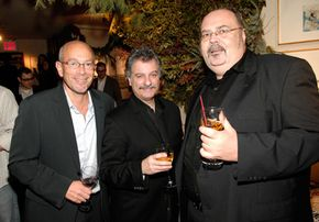 Music distributors like Alan Becker, left, and Bob Morelli, center, both of Reed Distribution shown here with Ed Christman of Billboard, work to get their clients' CDs in stores.