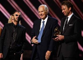 Producer George Martin, center, accepts an award with former Beatle Ringo Star, left, and fellow producer Giles Martin, right.