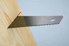 You should own two types of saws: A crosscut saw cuts against the wood grain while a ripsaw cuts parallel to the grain.