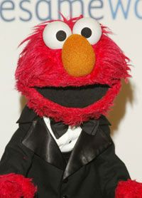 You can tell from Elmo's large pupils that he's a young Muppet.