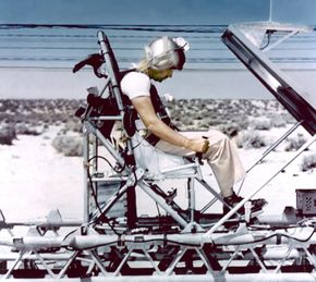 """Col. John Paul Stapp aboard the """"Gee Whiz"""" rocket sled at Edwards Air Force Base."""