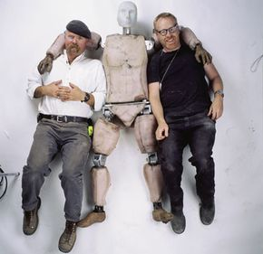 """Jamie and Adam get cozy with """"Buster"""" the crash test dummy."""