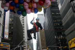 MythBuster Adam Savage performs the helium balloon stunt on Late Night with David Letterman.
