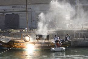 """""""MythBusters"""" host Jamie Hyneman and students from MIT try to sink a boat using Archimedes death ray (busted.)"""