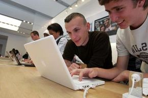 Customers at the Apple store in San Francisco try out the original MacBook back in 2006.