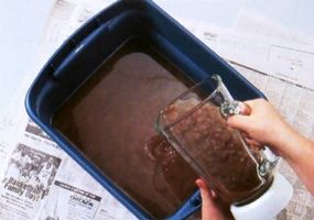 Blend the soaked paper and water until pulpy. Pour the pulp in a dishpan filled halfway with warm water.