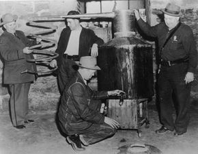 Ethanol production is entrenched in American history. Revenue agents in West Virginia examine the boiler of a still used to manufacture illegal moonshine alcohol.