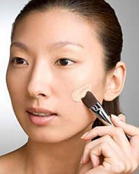 Smooth away imperfections with a dab of concealer.