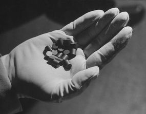 Pellets of natural uranium oxide fuel used for nuclear power.