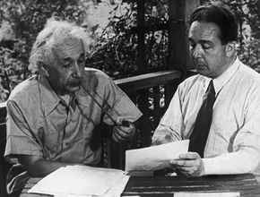 Albert Einstein and Leo Szilard in 1946, reenacting the signing of their letter to President Roosevelt warning him that Germany may be building an atomic bomb.