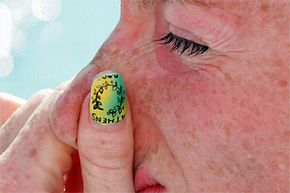 Sure, you could pick a nice mauve polish for your nails, or you could get creative and stencil some Olympic artwork on your nails as Australian swimmer Sarah Ryan did for the 2004 games.