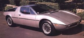 Styling on the Maserati Bora, by Giugiaro's Ital Design studio, was less radical than some rivals, but furnished more pleasing accommodations.The two-seat cockpit was well appointed and featured the world's first adjustable pedals.