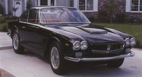 The Maserati Sebring in initial Series I form, Series II models wore a lower-profile hood scoop and hooded headlamps.