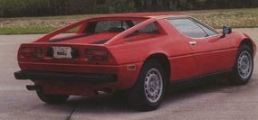 """The Giugiaro-styled V-6 Maserati Merak looked much like the V-8 Maserati Bora but had a flat deck and """"flying buttresses."""""""