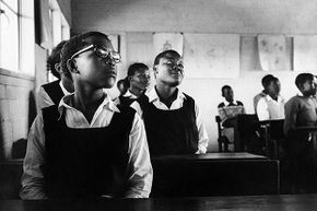 Girls sit in a classroom in Namibia, 1969. Back in 1962 in Tanzania (then Tanganyika), a laughing epidemic broke out at a girls' school.