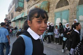 A Palestinian schoolgirl cries after Israeli forces use force to disperse a student protest in 2011. In 1983, both sides accused the other of deliberately trying to poison schoolchildren in the West Bank. The case was deemed one of mass hysteria.
