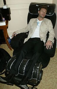 Television host Ryan Seacrest catches a quick nap in an iJoy massage chair. Seacrest out!