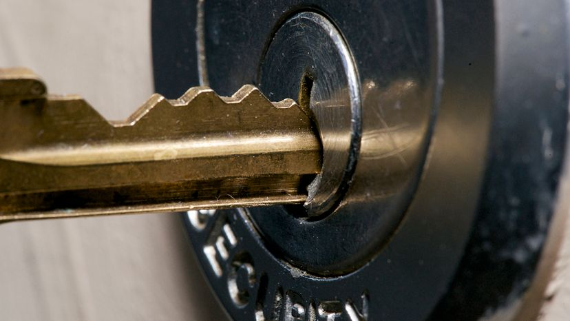 A master key entering a door lock