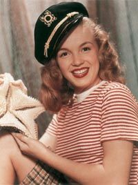 Early Marilyn Monroe photos                                            exuded a delightful                                            wholesomeness.