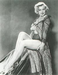 """""""Leg art"""" photo sessions were a never-ending part of Marilyn's career, and one that she worked at with enthusiasm and good humor."""