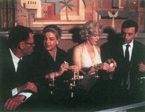 In January 1960, Marilyn readied herself to begin work on Let's Make Love. She relaxes here with Arthur Miller, actress Simone Signoret, and costar Yves Montand.