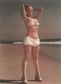 Norma Jeane's swimsuit photos became particularly popular with magazines and their readers. This one was taken circa 1948.