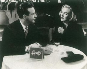 Marilyn's bit part in Right Cross let her play opposite popular leading man Dick Powell, but the picture was a minor one.