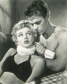 Peggy's relationship with her boyfriend in Clash by Night is roughly physical, and she reacts to the bit of domination shown above by hauling off and socking her fella on the jaw. To Marilyn, the character's vigor must have been sweet relief after the succession of two-dimensional glamour-girl roles.