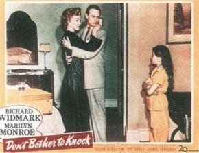 Don't Bother to Knock was a milestone in Marilyn's career because it marked her first attempt at a heavily dramatic starring role. This lobby card shows her with costar Richard Widmark and child actress Donna Corcoran.