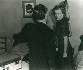 Don't Bother to Knock does have its share of melodrama, as in this scene, in which the babysitter threatens to brain her well-meaning uncle, played by Elisha Cook, Jr.