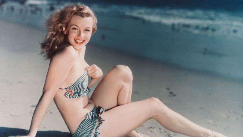 Marilyn Monroe laying on a Los Angeles beach